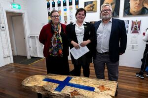 Southern Cross College Burwood student Charlotte McCaughan with her Clancy Prize artwork and parents